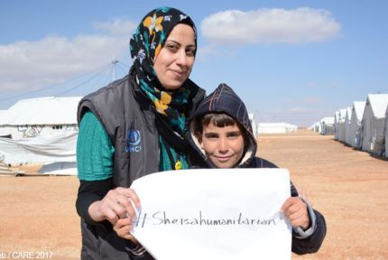 Asma Abdullah with a young boy at Azraq refugee camp