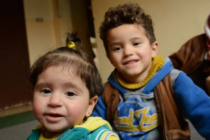 Two young cousins in an apartment in Jordan