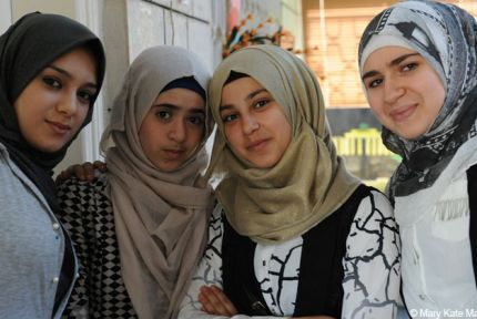 Four girls at a peer-to-peer support group in Jordan