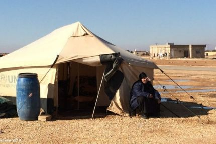 Syrian woman outside tent in Jordan