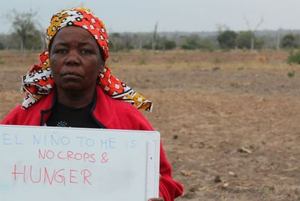 A woman in Mozambique holding a sign