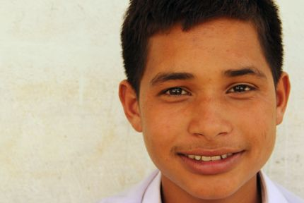 Portrait of Bibek, a schoolboy in Nepal