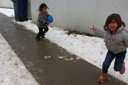 Girls playing in the snow