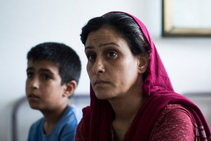 Refugee woman and her son