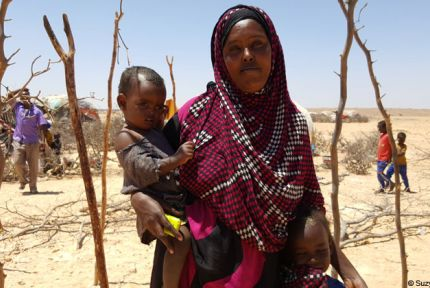 A woman and children at a temporary camp in Somaliland