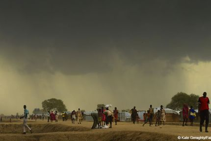 Storm clouds over displaced person camp, South Sudan