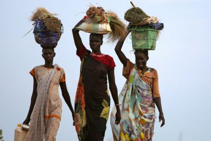 Three women walking in South Sudan