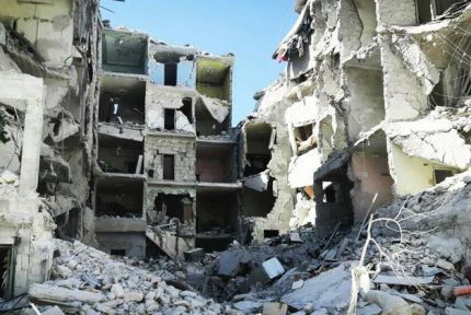 A bomb-damaged building in eastern Aleppo