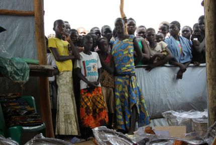 South Sudanese refugees in Uganda awaiting an aid distribution
