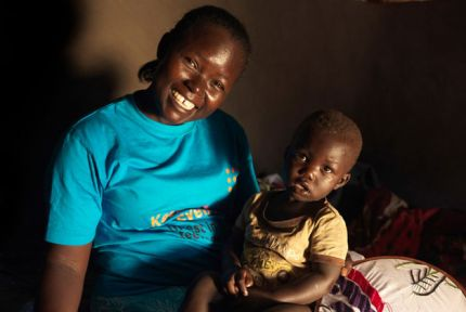 Joyce and child, refugees from South Sudan in Uganda