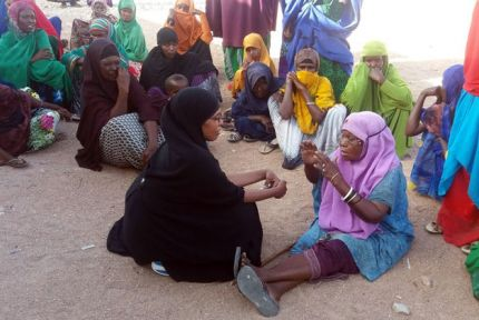 Amrea talking to group of women