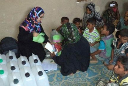 CARE staff distribute food vouchers in Yemen