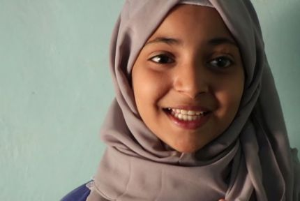 Portrait of Malak, a young girl in Yemen