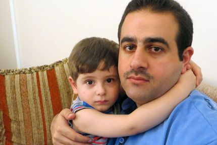 Saaed and his three-year-old son Rafia © CARE