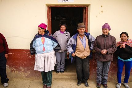 Members of the Native Potato Producers stand outside the potato seed bank in Uñas village, Peru