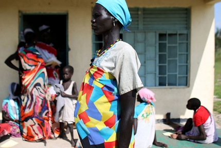 A pregnant woman waits outside the antenatal care centre in Yuai South Sudan © CARE / Josh Estey