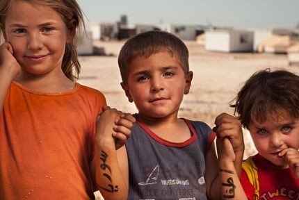Three Syrian refugee children © CARE