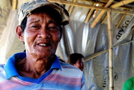 Your donations are helping Ronaldo and his family rebuild the home they lost to the typhoon © CARE