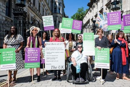 Campaigners assemble to call on G7 leaders to invest in gender equality.