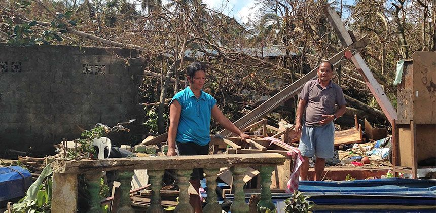 Rizza and Julio Cui survey the wreckage of their home in eastern Samar