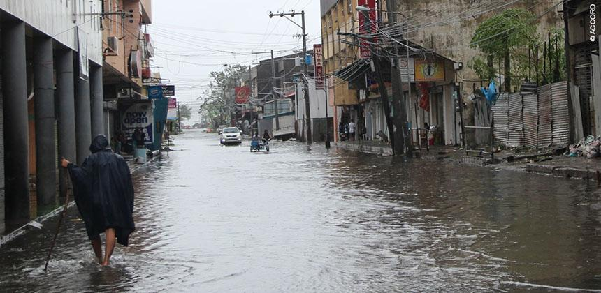 Some parts of Tacloban were flooded after Typhoon Hagupit An evacuation centre in Tacloban © ACCORD