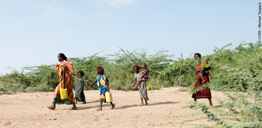 Women and girls walking for water